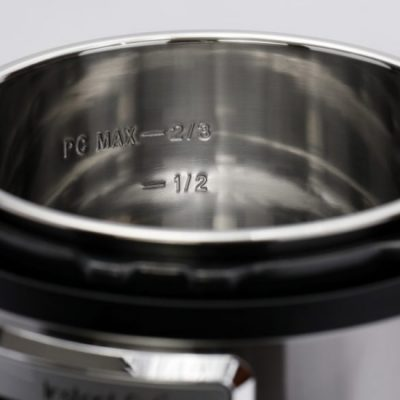 Close up of an open electric pressure cooker to consider Instant Pot Duo Nova Accessories